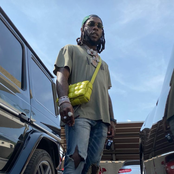 Mixed Reactions As Burna Boy Was Spotted With A Lady's Handbag, Checkout What People Are Saying