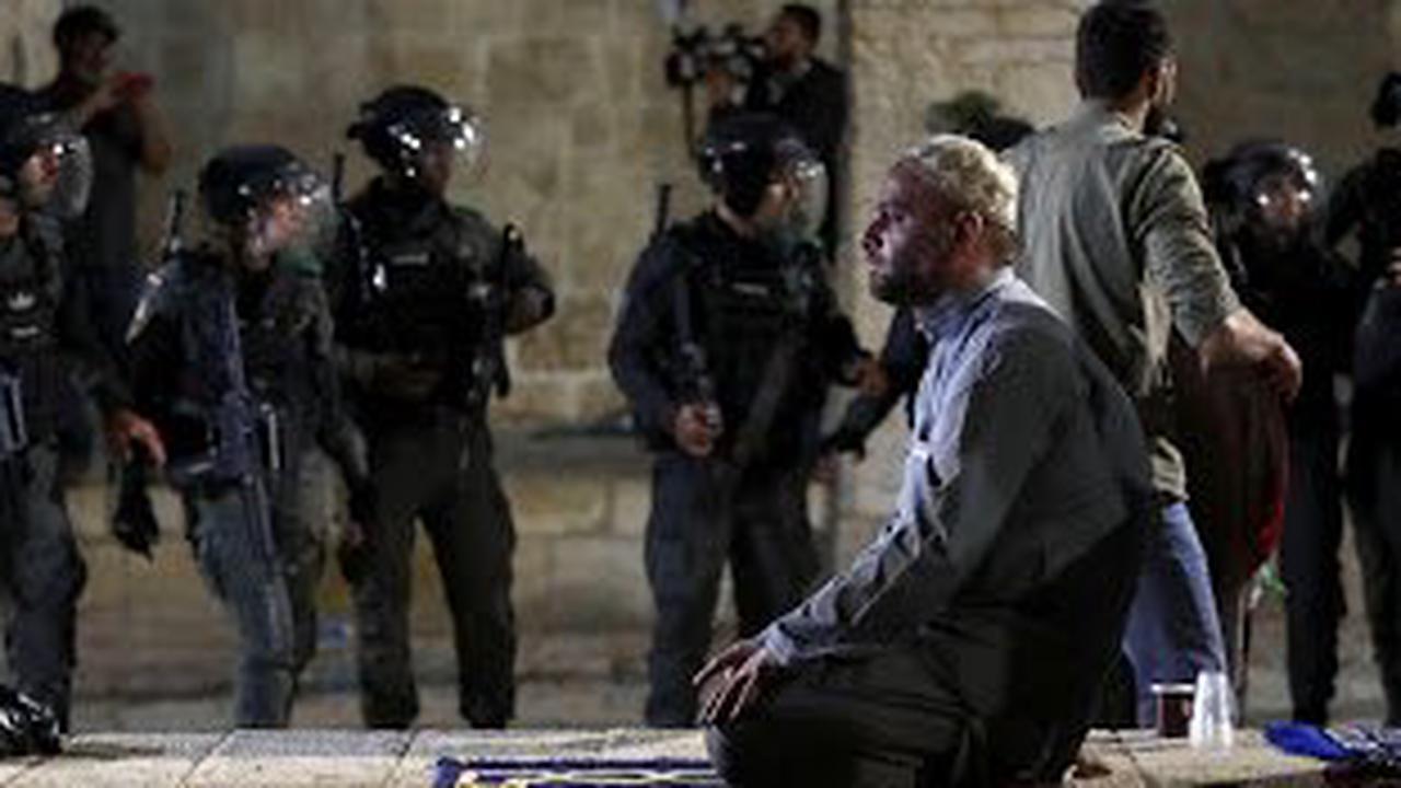 Palestinians, Israel police clash at Al-Aqsa; dozens hurt
