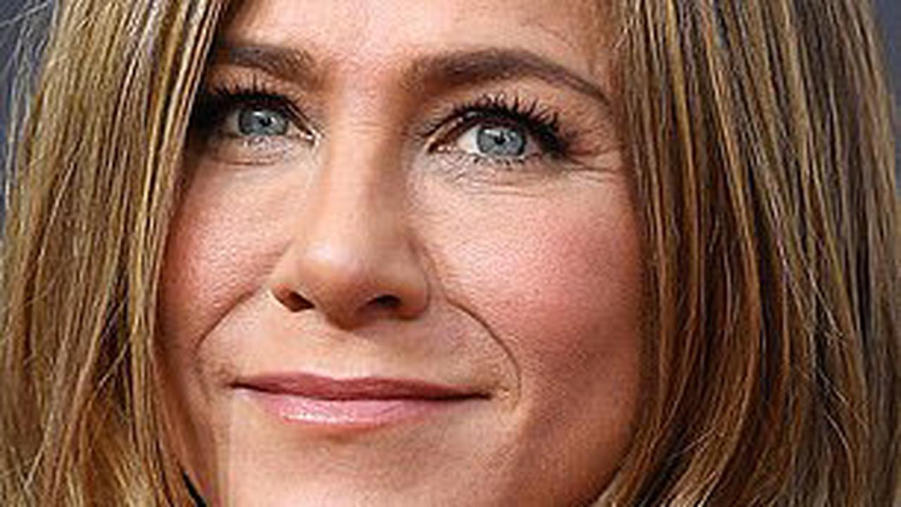 'We're buddies!': Jennifer Aniston says there is no 'oddness' with ex-husband Brad Pitt... after they had palpable chemistry during Fast Times table read