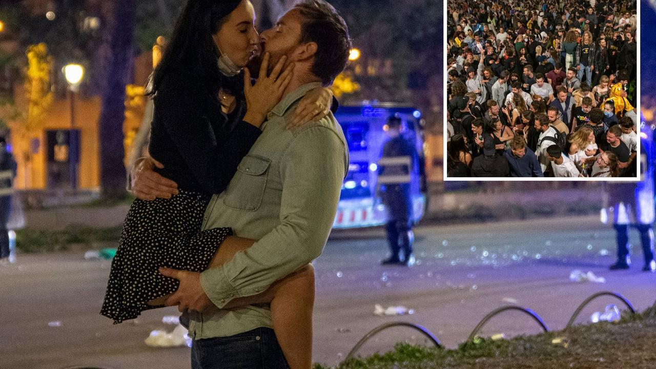 Couple celebrates end of Spain's Covid lockdown as street parties erupt