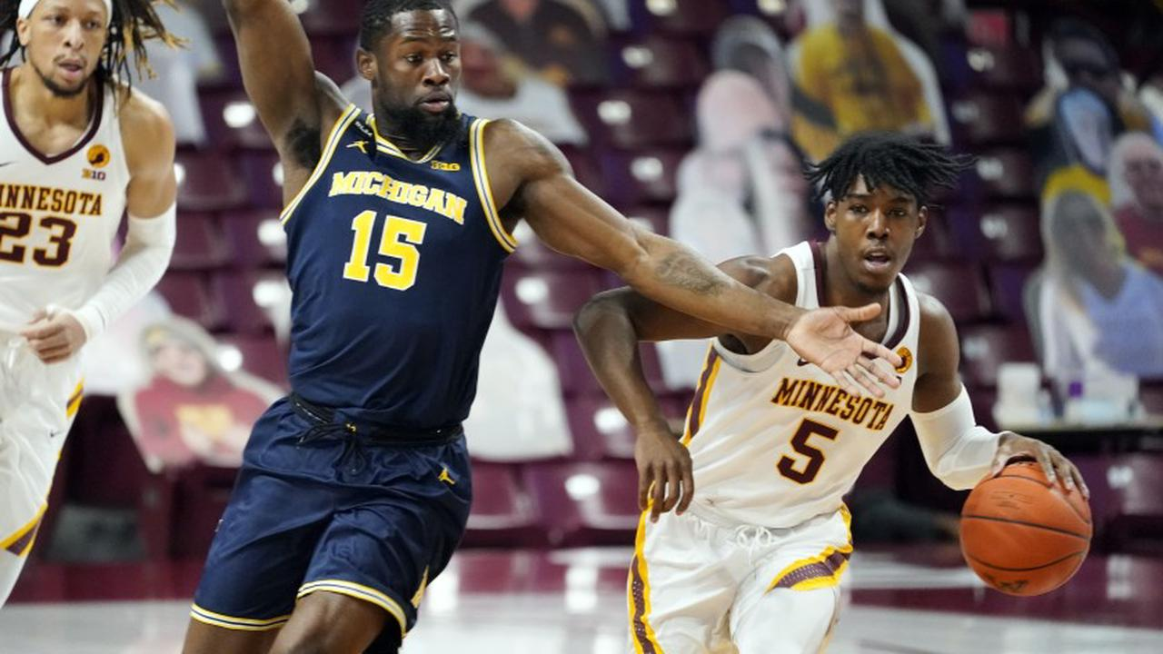 No. 23 Minnesota hands No. 7 Michigan 1st loss in 75-57 romp