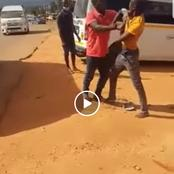 Watch| Two Motorists Fighting In Public Until One Gets Bumped By A Passing Vehicle