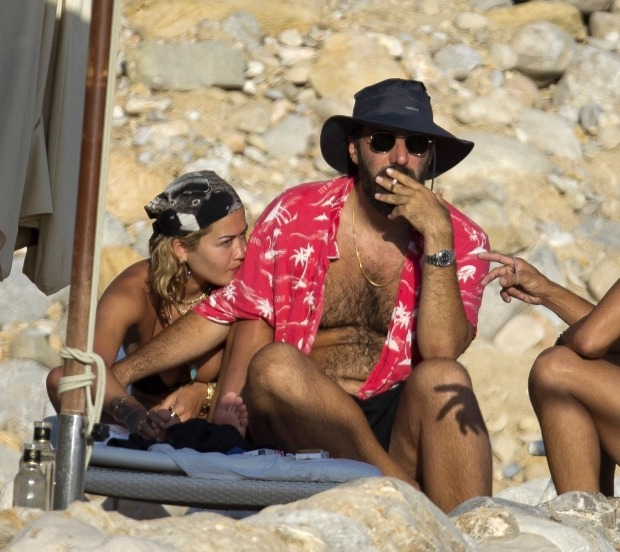 Rita Ora goes topless as she sunbathes with her boyfriend Romain Gavras and friends in Ibiza (Photos)