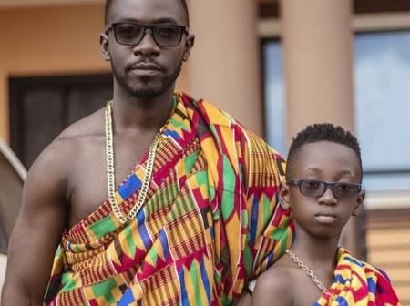 Okyeame Kwame treats fans with this beautiful pose with his son in their Kente cloth