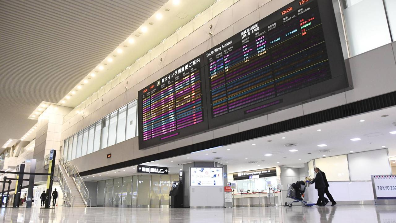 Who is affected by Japan's tightened travel controls over the new coronavirus strain?