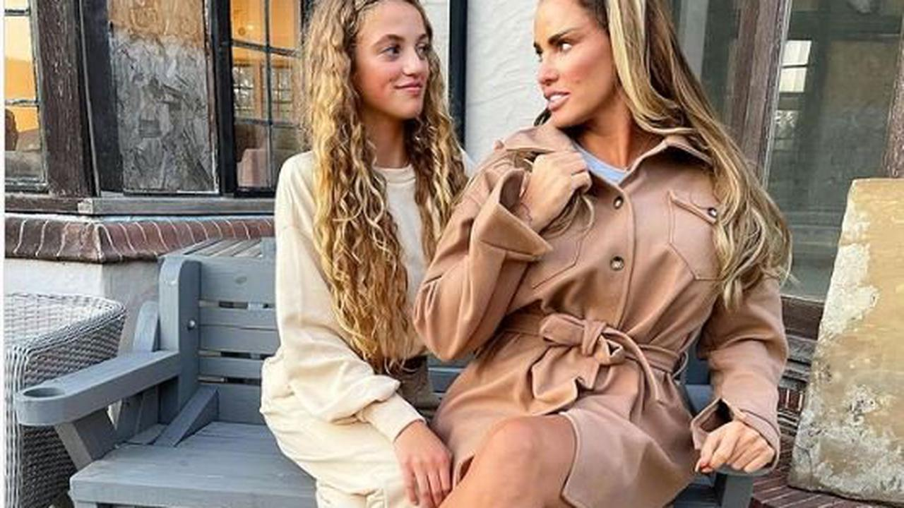 Katie Price reveals boarded up broken windows at Mucky Mansion as she poses with daughter Princess
