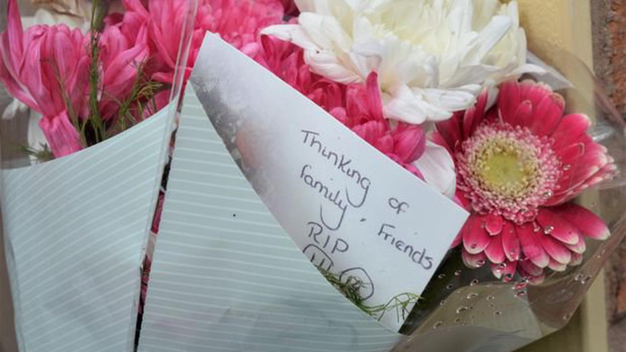 Flowers left on street after suspected murder of woman