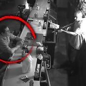 This man enjoyed his beer while robbers raided his favorite bar