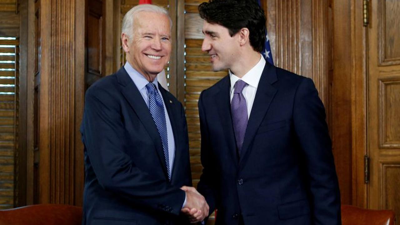 Canada's Trudeau embraces Biden in bid to turn page on Trump era By Reuters
