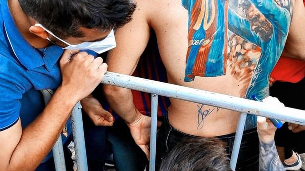 Lionel Messi honours promise by signing fan's incredible Barcelona back tattoo