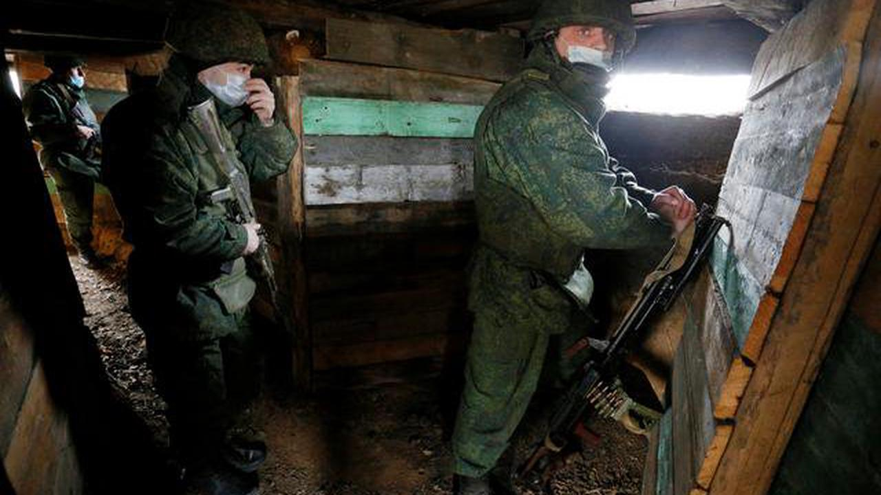 Merkel tells Putin to pull back troops as Kremlin accuses Ukraine of provocations