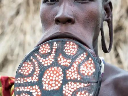 Checkout Lips Stretching tradition of Surma tribe where lip plate is inserted into the mouth