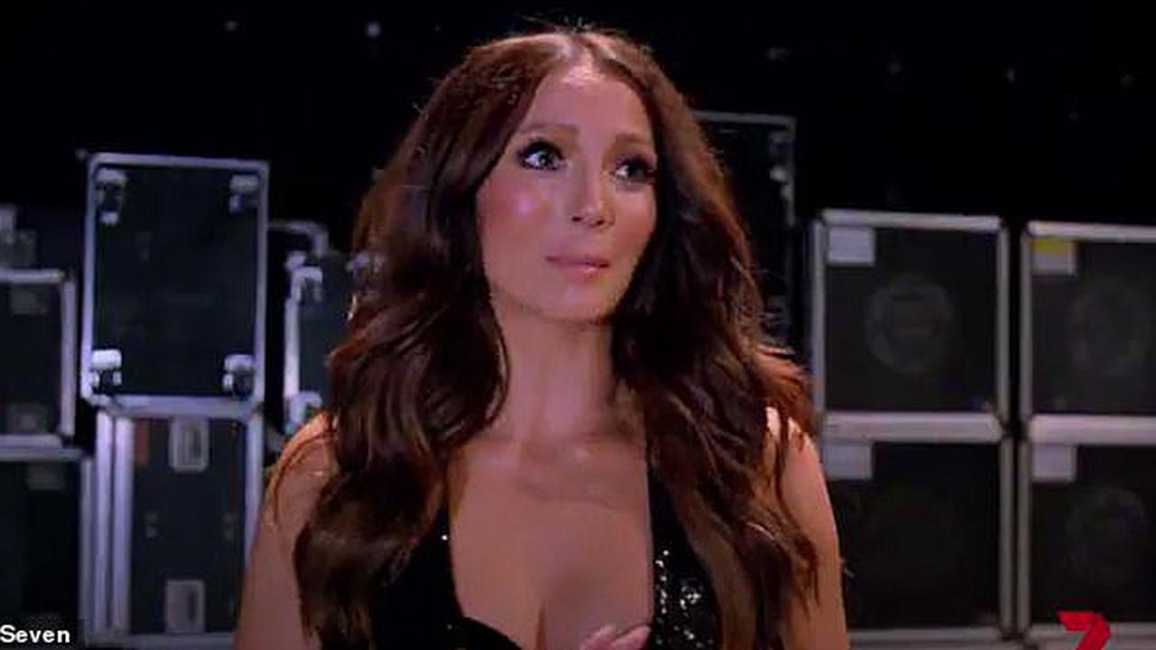 Ricki-Lee Coulter shows off her sensational figure in an electric blue one piece during beach holiday in Queensland