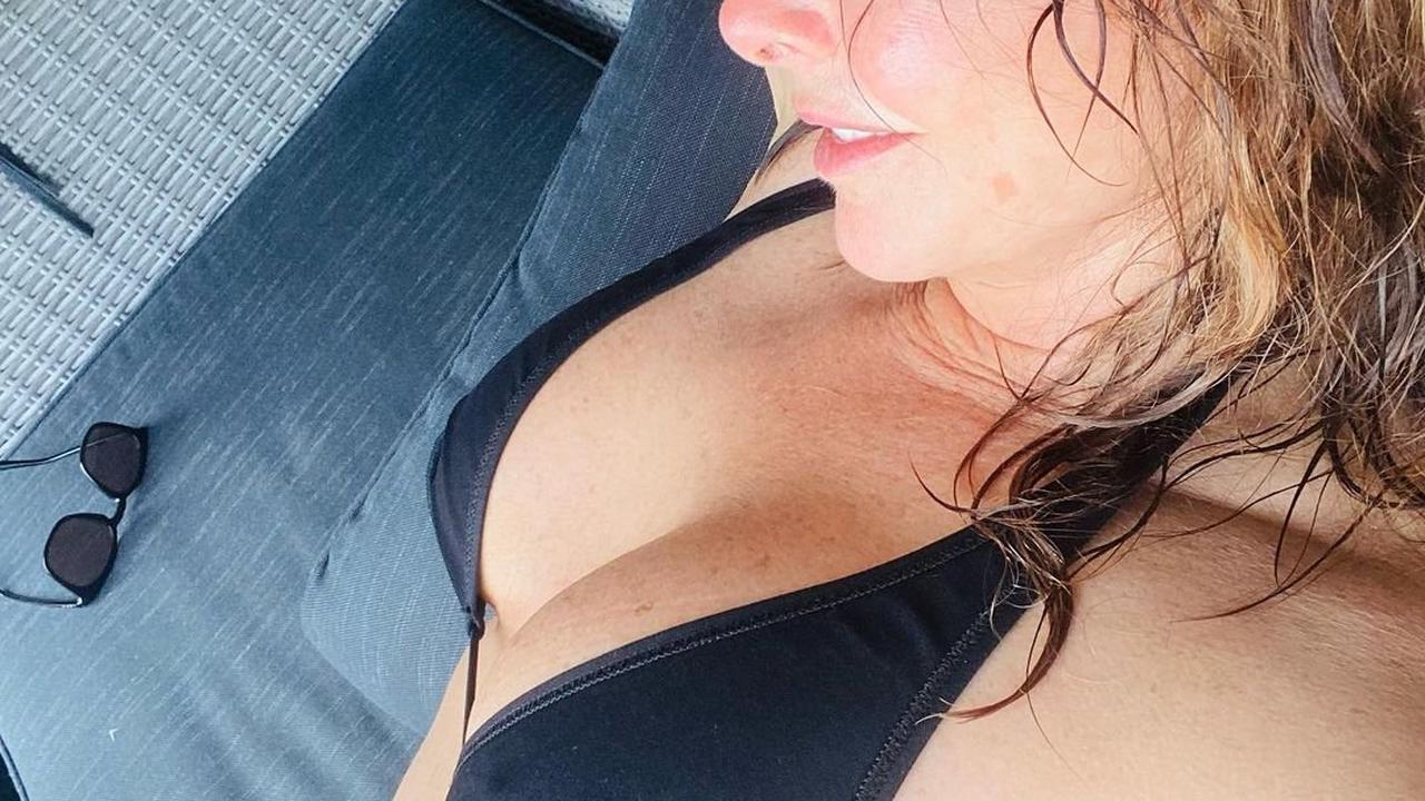 Carol Vorderman left red-faced after fans point out bikini blunder as she sunbathes in swimwear