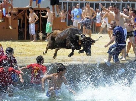 The Spanish Festival Where Bulls Chase People To The Sea