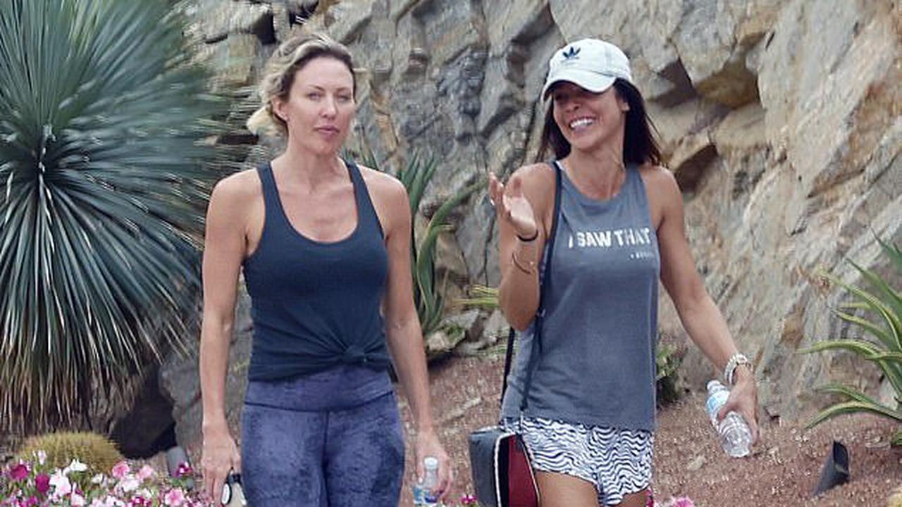 Braunwyn Windham-Burke works up a sweat with new girlfriend Fernanda Rocha in Palm Springs... after being fired from Real Housewives of OC