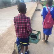 Reactions As A Little Girl Carries Stove Along With Her While Going To School