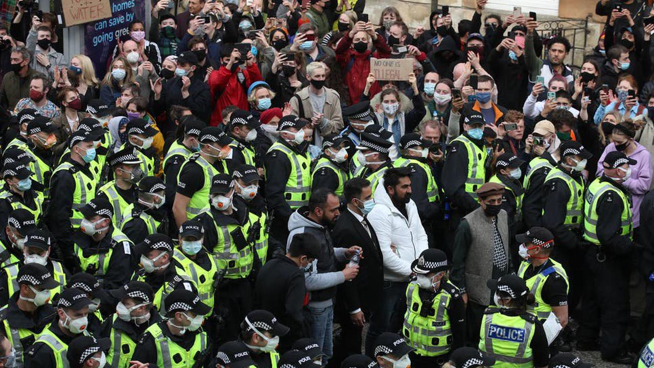 Men detained by immigration enforcement released by police after protest