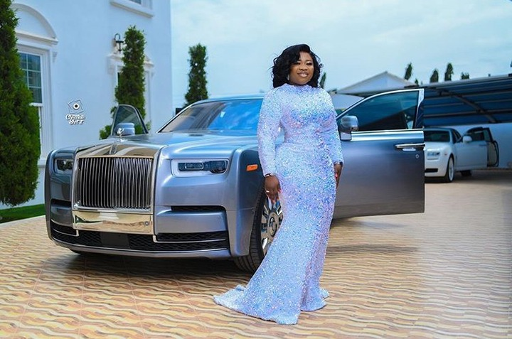 38b9175d5fabbfb76bfebf54b13165bf?quality=uhq&resize=720 - Rev Obofour's Wife Flaunts Her Curvaceous Body & Rolls Royce As Her Celebrates Her 33rd Birthday