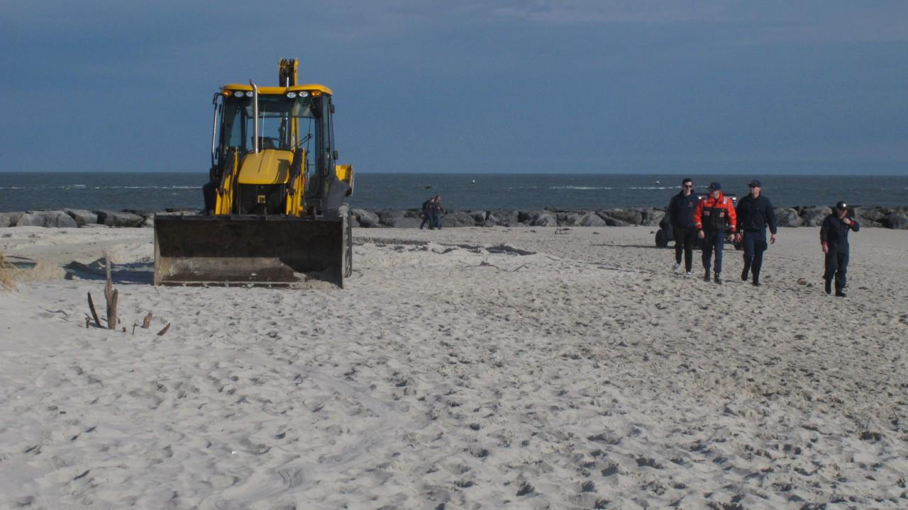 Dead, frozen whale buried on NJ beach after removal deemed too difficult