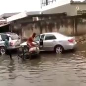 After This Man Got Stuck In The Midst Of Flood With His Car, Check Out The Funny Thing He Did
