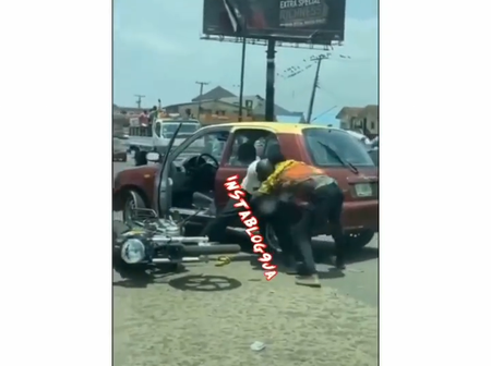 Video: Cabbie And Bike Man Engaged In A Brutal Fight In Ibadan, See What Caused The Fight