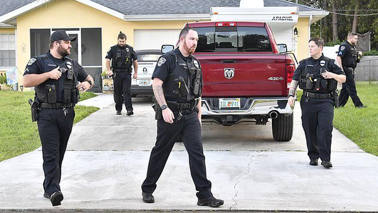 EXCLUSIVE: Cops surround home of Brian Laundrie's parents and quiz his mom after 'prankster' reported gunshots at their Florida property