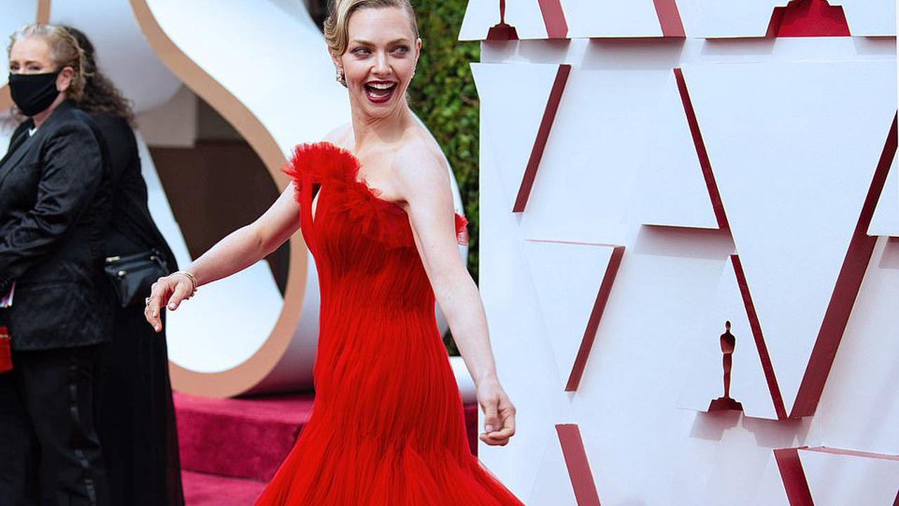 Now that's a RED carpet! After a year under wraps, Hollywood glamour bursts back with a blaze of colour