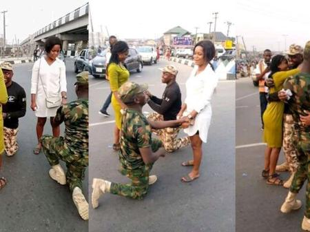 Check Out Romantic Moment Two Nigerian Soldiers Proposed To Their Girlfriends On A Busy Road