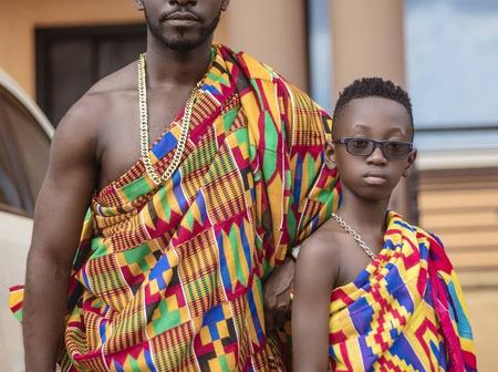 Okyeame Kwame's Son Is A Legend, See How He Matches His Father Boot For Boot