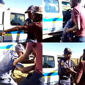Watch : SAPS officer caught drunk on the job, community confronts him for crashing vehicle.