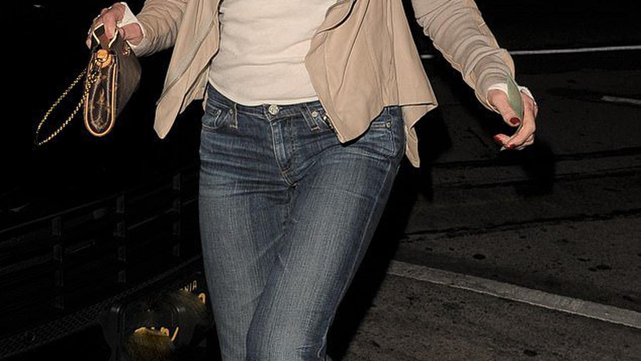 Melanie Griffith, 63, is casually stylish in beige thumb hole jacket and low-rise blue jeans on night out in LA