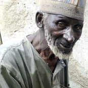 Photos of Buhari's former driver receiving relief materials surface online