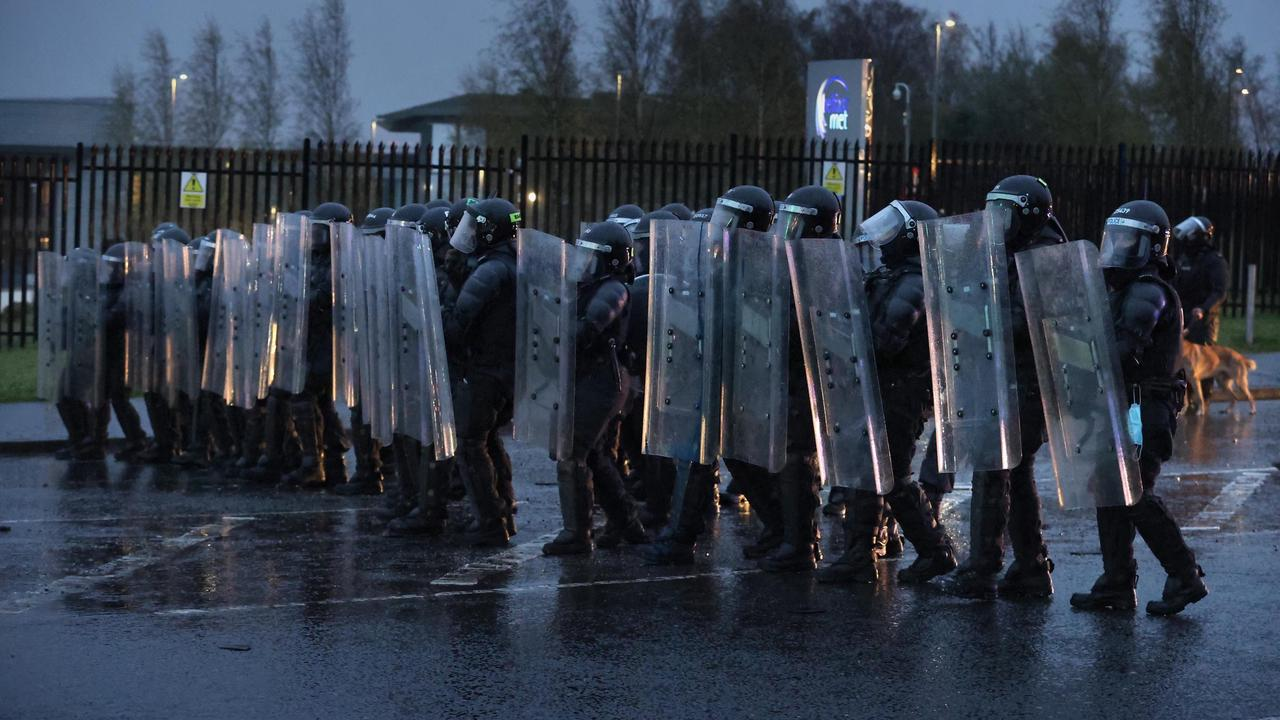 Police blast rioters with water cannon as violence flares again in Northern Ireland