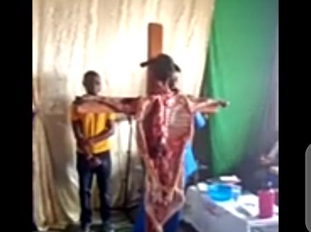 S£e Church Members Shouting, kneeling and Worshipping an opened up crucified Sheep