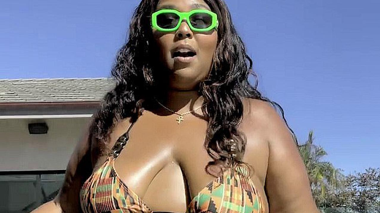 'Big grrrl summer is here!': Lizzo poses in a string bikini as she puts her personal spin on Megan Thee Stallion's Hot Girl Summer