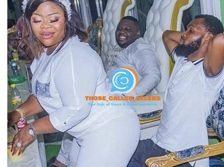 Rev. Obofuor's wife seen dancing for her seated husband
