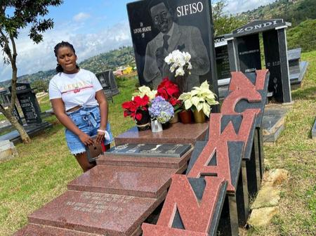 Sfiso Ncwane's daughter visits her father's grave. Living fans touched by the moment.