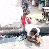 Man spotted lying on the gutter for his pregnant wife to pass (photos)