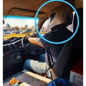 A Taxi driver was spotted wearing a helmet instead of a mask.