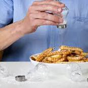 If You Like Adding More Salt To Food While Eating, See The Health Implications