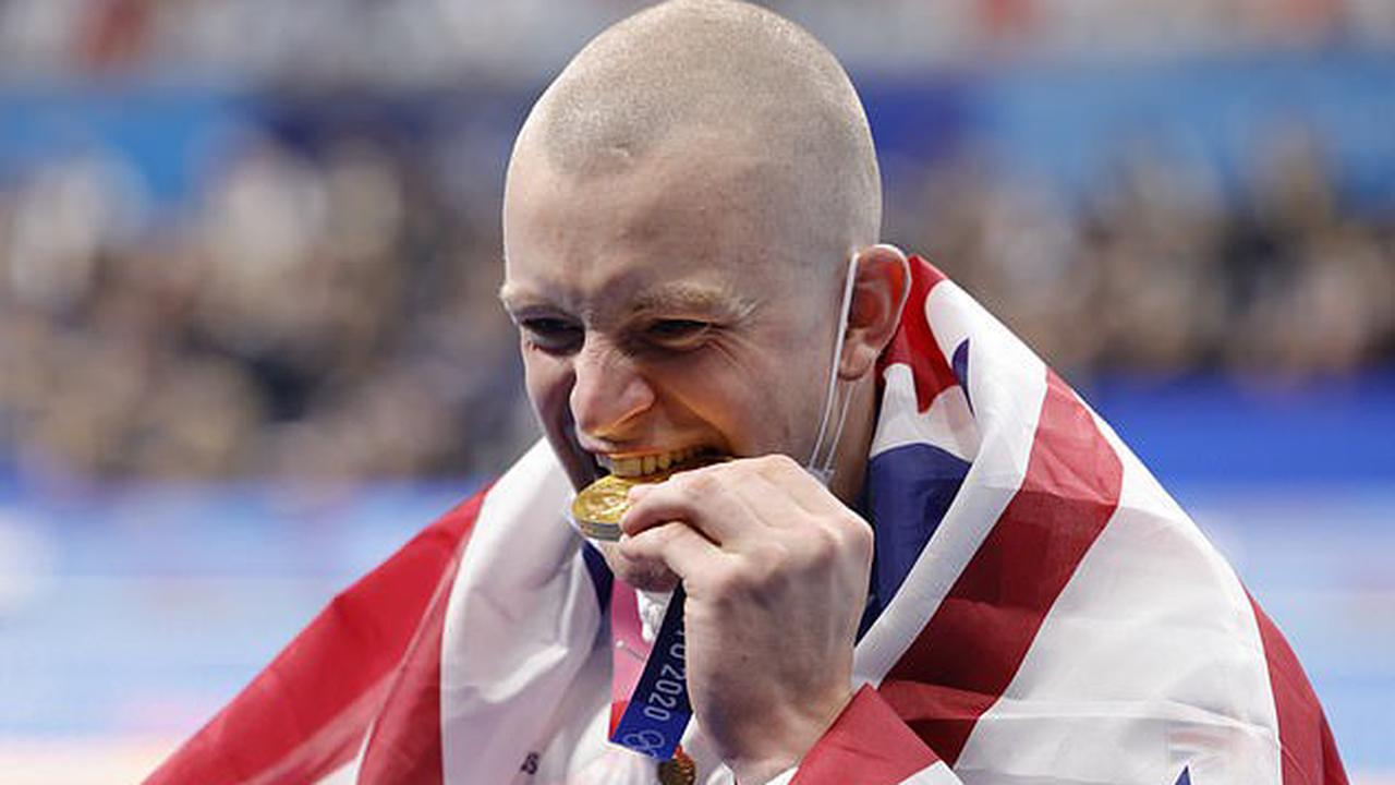Olympics organisers tell winners NOT to bite their medals on the podium as they pose for photographs - because they are actually made of recycled mobile phones!