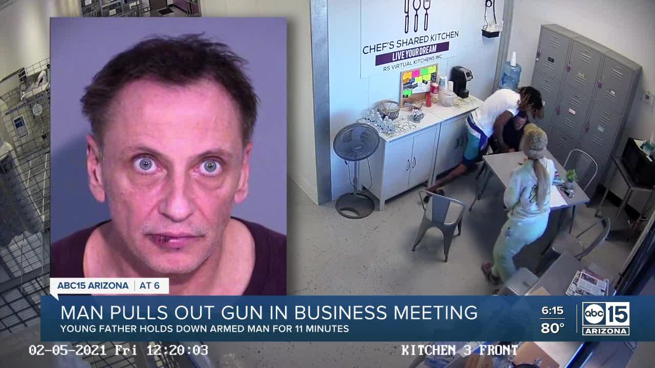Father disarms man after gun is pulled during meeting
