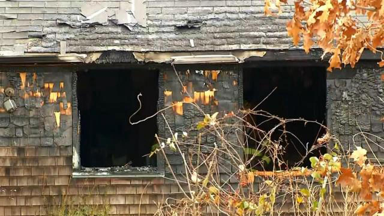 Woman pulled from burning home, fire caused by Christmas decorations