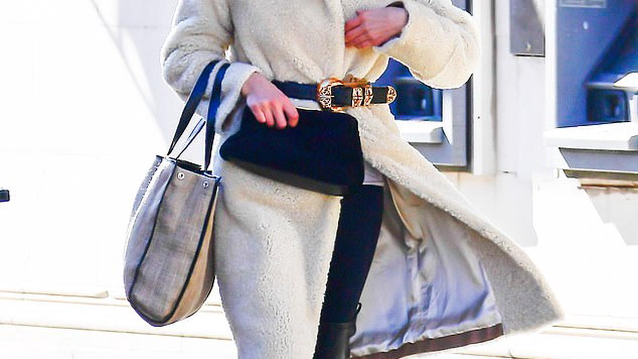 Irina Shayk cuts comfortable yet chic look in long white teddy coat and Chrome Hearts beanie while walking to photoshoot in New York City