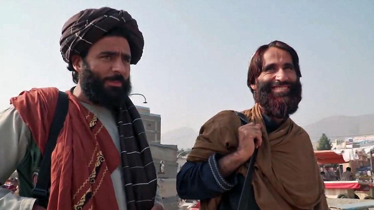 Taliban shoppen lachend von verzweifelten Afghanen