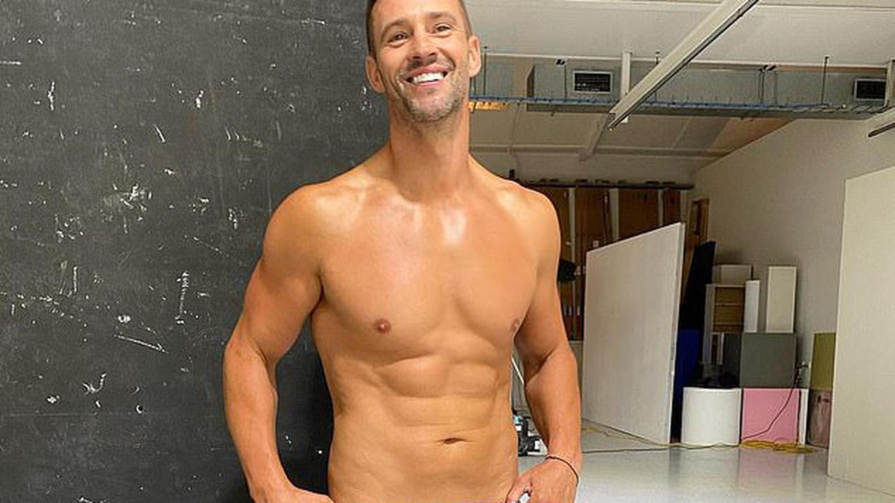Kris Smith shows off his fit physique in tight underwear during photo shoot - and admits there was a lot of 'shrinkage' due to the cold weather
