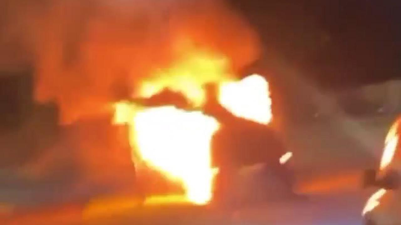 Moment fireball engulfs car set alight by arsonists in street