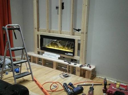 The DIY homemade fireplace turned A boring wall into The best part of The house