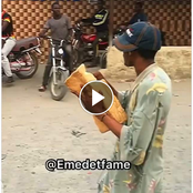Comedy Video: Nigerian Man Disguised As Madman Holding A Giant Bread & Scaring People On The Streets